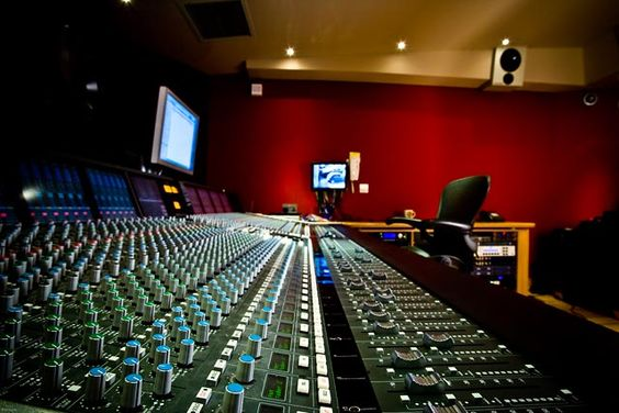 Typical Solid Stage Logic (SSL) mixing console in a recording studio